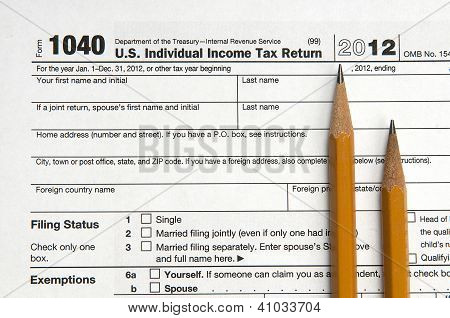 View of United States tax form with two sharpened pencils