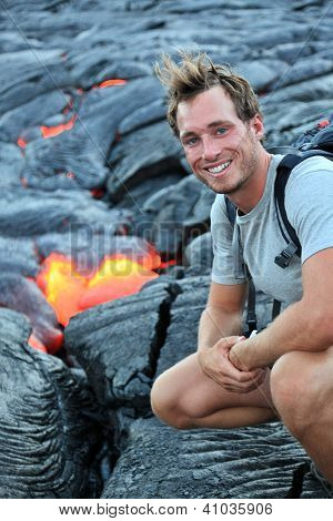 Hawaii: Hiker seeing lava from Kilauea volcano around Hawaii volcanoes national park, USA. Young caucasian man hiking.