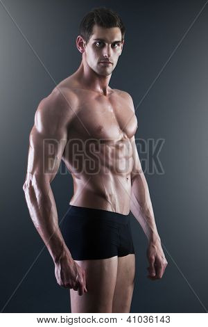 Portrait of a young sexy shirtless muscular man in underwear