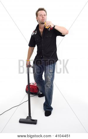 Man With Vaccum Cleaner And Beer