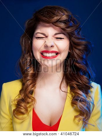 Portrait of an attractive young woman laughing hard