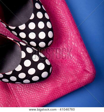Polka dot high heels and snakeskin print bag
