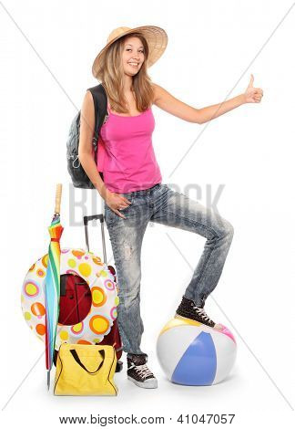 Young woman going to holidays with her suitcase and beach equipment.