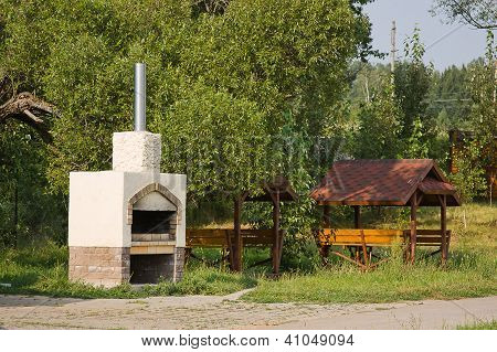 Arbour  And Stove In A Beautiful Park In Summer In A Sunny Day