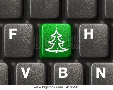 Computer-Tastatur mit Weihnachtsbaum Schlüssel