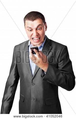 An Angry Businessman Screaming In Cell Mobile Phone Isolated On White Background