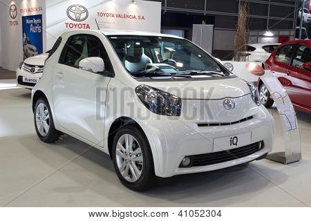 VALENCIA, SPAIN - DECEMBER 7 - A White 2012 Toyota iQ Supermini Vehicle at the Valencia Car Show on December 7, 2012 in Valencia, Spain.