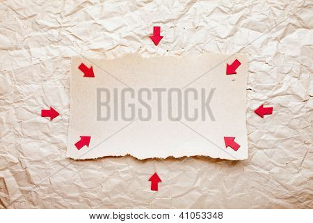 Ripped Piece Of Paper With Red Arrows On Old Crushed Paper Background. Vintage Retro Card