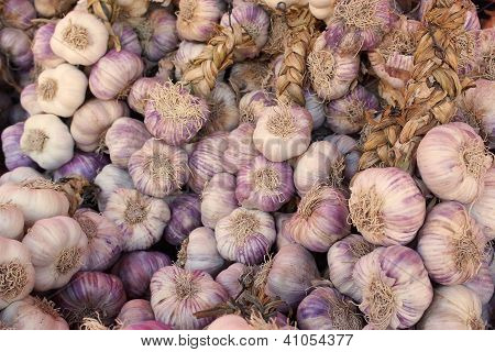 Strings Of Garlic At The Market, Provence, France.