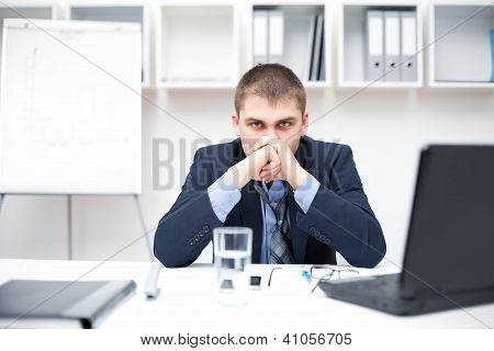 Thoughtful Young Businessman In Office