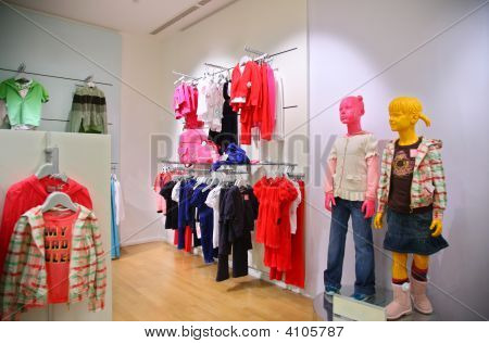 Children`s Mannequin In  A Empty Modern Shop