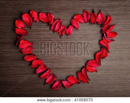 Valentine's Day Background. . Petals Of Red Roses In The Shape Of A Heart On A Wooden Background