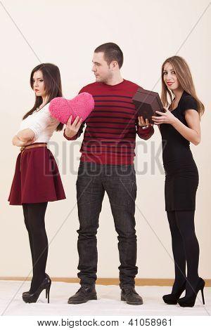 Boyfriend choosing between girlfrinds while one girlfriend is angry