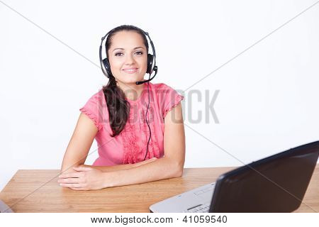 Call Center Female Operator. Young Happy Smiling Woman Sitting At Office Desk With Headset Isolated