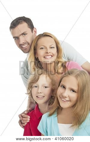 Group Of Four People Standing Together And Smiling