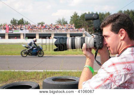 Photographer On Motorcycle Race