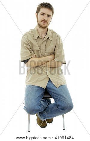 young bored casual man on a chair, isolated on white