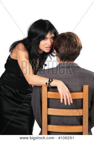 Beautiful Brunette In Black Dress Whispers On Ear Man
