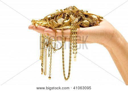 Mão segurando ouro