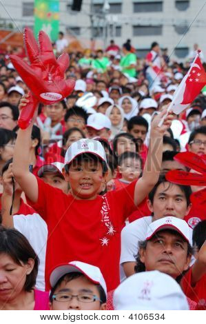 Boy Holding Glove And Singapore Flag