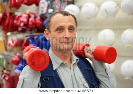 Man With Dumbbells In Sport Store
