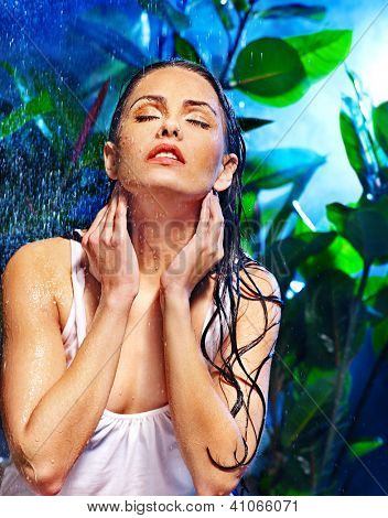 Wet woman with water drop. Nature.
