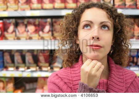 Girl In Store Looks Upward