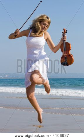 Young Beautiful Violinist Jump On Beach
