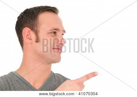 Smiling Young Man Pointing A Finger
