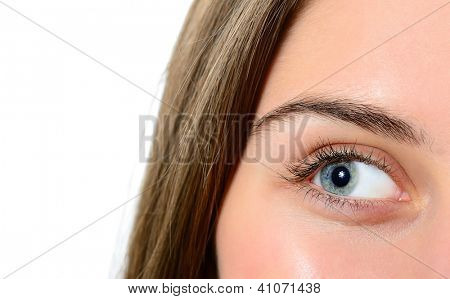 female green-blue eye closeup, looking left