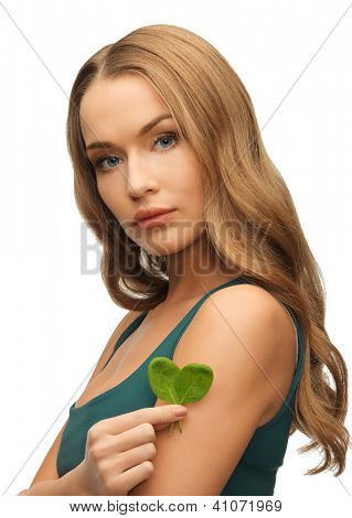 bright picture of woman with spinach leaves