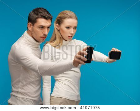 picture of man and woman with modern gadgets