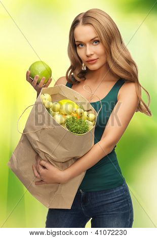 picture of woman with shopping bag full of fruits
