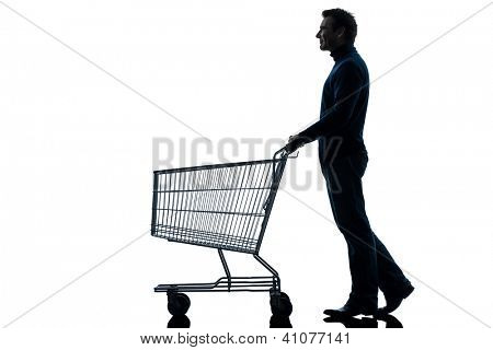 one caucasian man with empty shopping cart in silhouette studio isolated on white background