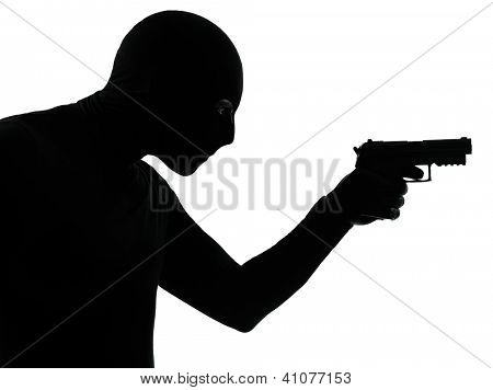 thief criminal terrorist man aiming gun in silhouette studio isolated on white background