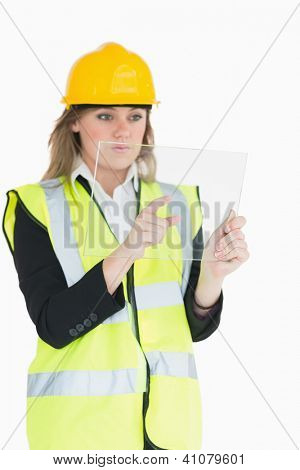 Female architect pressing something while holding the pane