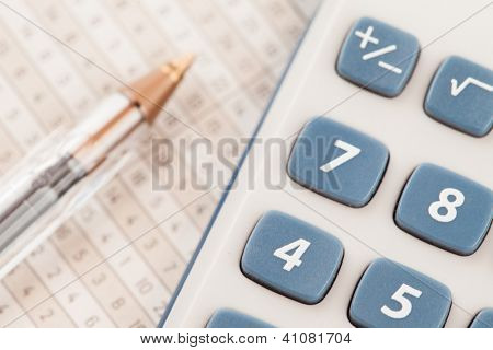 Sector of calculator and biro on maths tables