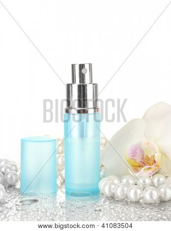 women's perfume in beautiful bottle and orchid flower, isolated on white