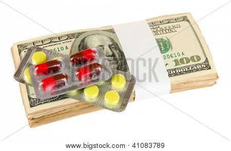 Pills and money isolated on white