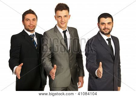 Team Of Business Men Giving Handshakes