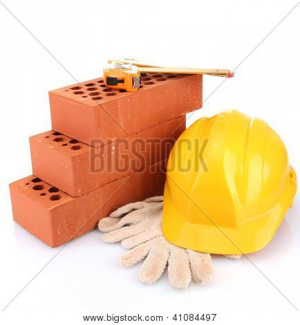 helmet, roulette, bricks and gloves isolated on white