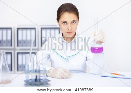 Young Chemical Female Researcher Working With Chemicals In Laboratory