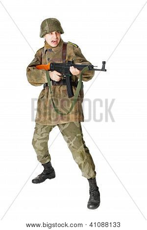 Soldier Shoots Submachine Gun Isolated On White