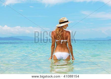 Beautiful Young Woman In Bikini On The Sunny Tropical Beach Relaxing