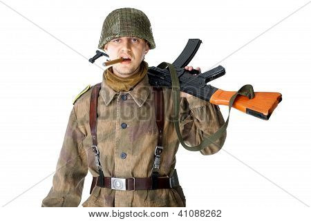 Soldier With Machine Gun Smoking A Cigar
