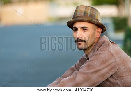 Classic or old school dressed latino male with a mustache
