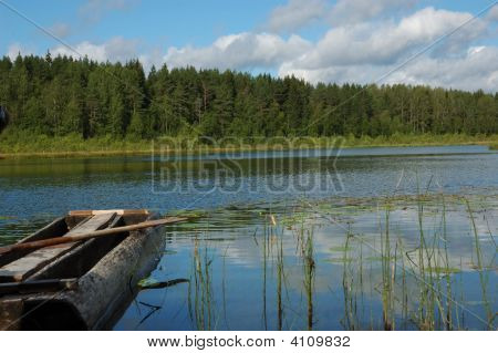 Forest Lake With Old Fishing Boat