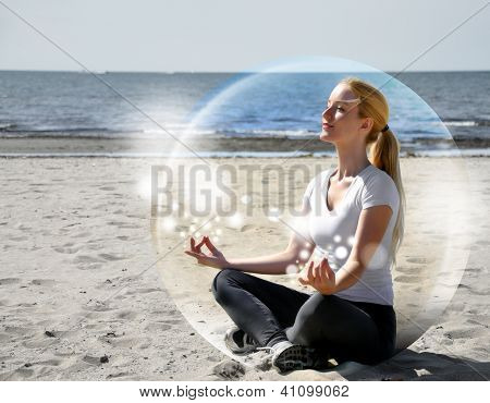 Woman Meditating On Beach In Peace