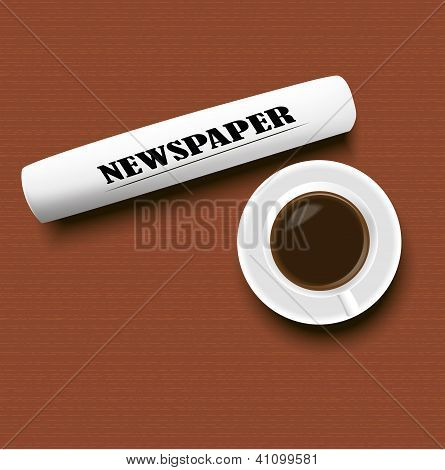 A Cup Of Coffee And A Newspaper On The Table