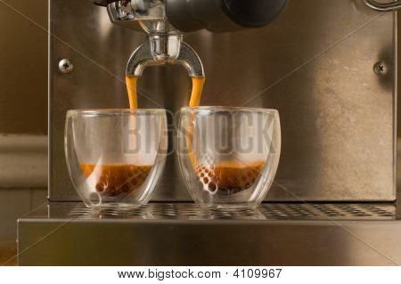 Double Shot Of Espresso Poured Into Glasses